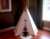 Five sided tribal painted cream teepee tent with light stained wooden polls