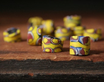Antique Venetian glass, African trade beads, 12 antique glass beads