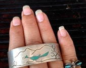 Sterling Zuni Cuff with inlaid turquoise roadrunner bird and desert background