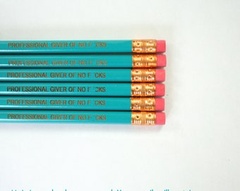 professional giver of no f*cks Pencil set of 6 engraved pencils in teal. MATURE swears. Not for children or sensitive adults.