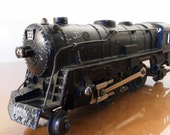 Vintage 1940s Marx Cast Iron 999 Steam Train Engine. O Scale.  In good intact condition with age and play wear.