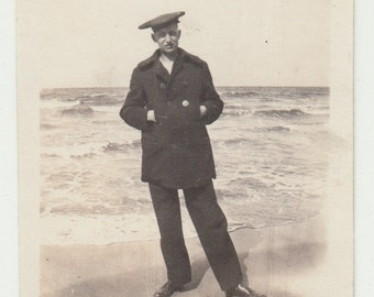 Vintage/Antique photo of a man by the beach