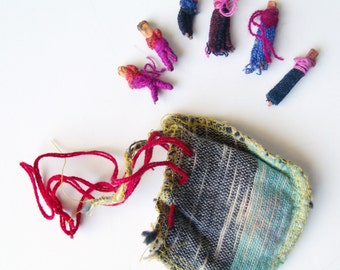 "Six Vintage ""Worry Dolls"", Tiny Handmade Dolls with Homemade Pouch"