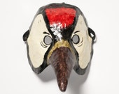 Paper mache woodpecker mask