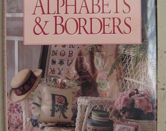 better homes and gardens cross stitchers big book of alphabets and borders hardcover
