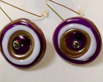 Striking purple lustre disc lamp work glass bead earrings on round sterling silver ear wires.