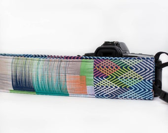 DSLR camera strap cover with lens cap pocket.  blue, green, orange squares with zig zag.