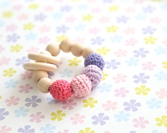 Baby ring toy with crochet wooden beads. Rattle for baby. Natural teether. Rosa violet