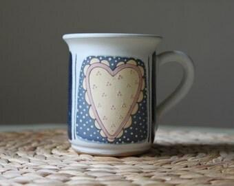 Tall tea cup with creamy heart