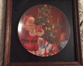 """Framed 1982 Christmas edition from the Norman Rockwell collection of legendary art """"Santa's Secret"""""""