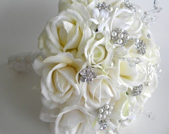 The Michelle Bouquet in Ivory - Rhinestone and Pearl Real Touch Rose Bouquet in White & Ivory  Brooch Bouquet.