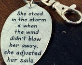 She stood in the storm and when the wind didn't blow her away, she adjusted her sails  -Elizabeth Edwards keychain
