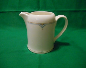 One (1), 6 oz Creamer, from Villeroy & Boch, in the Structura Pattern.