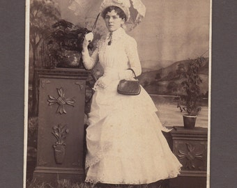 Cabinet Card of a Beautifully Dressed Woman with a Purse and Parasol