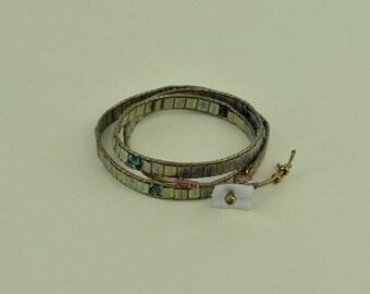 Tila and Czech fire polished beads leather wrap bracelet.
