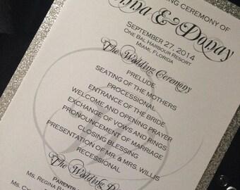 wedding program in silver glitter and white shimmer paper