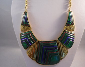 Gold Bib Necklace with Green, Rust,and Purple Pendants on a gold chain