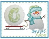 Personalized, appliqued snowman pulling snowball on sled t-shirt or onesie.