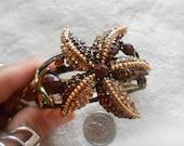 High Fashion-Goldtoned Designed Crystal Rhinestone Clamper Bangle-Brown Starfish