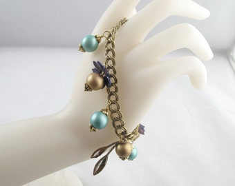 Old Gold and Aqua Charm Bracelet on Parallel Curb Chain