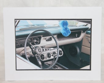photo card, steering wheel of a classic Mustang