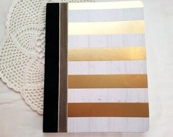 Gold Journal with white stripes and black velvet binding
