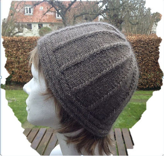 Hand knitted beanie knitted with QIVIUT and Suri alpaca blend