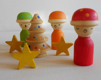 Wood waldorf toy of winter snow babies peg people with stars and fir tree