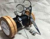 Midnight Owls embroidery kit in a wooden bobbin set with scissors and thread catcher.