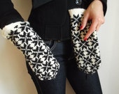 Hand knitted wool mittens in black and white