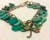 Repurposed Upcycled Button Bracelet with Teal and Turquoise Buttons and Dragonfly Charm