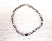 Hematite cube bracelet with silver glass seed beads