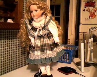 porcelion doll in blue plaid dress