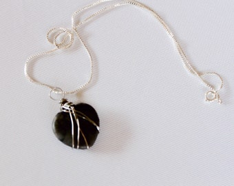 Heart shaped rock pendant on a sterling silver plated necklace