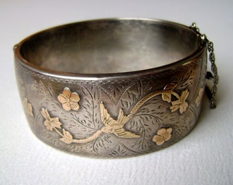 gorgeous hinged bracelet, sterling with gold bird and flowers