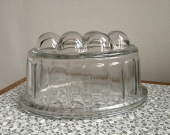 Wibble wobble wibble wobble jelly on a plate.  Glass jelly mould.