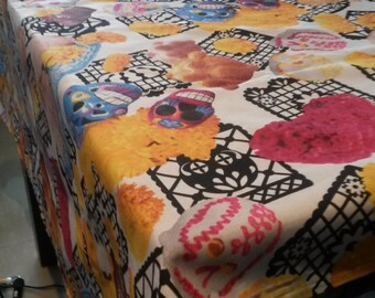 1.8 yards X 1.25 yards of Mexican  with colorful designs like calaveras,  day of the death