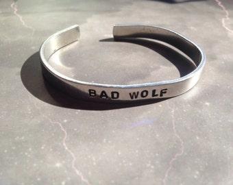 Bad Wolf - hand stamped metal cuff