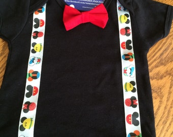 Mickey mouse susbenders and bow tie on onesie.