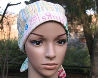 Ladies scrub cap novelty print with loving words for babies.