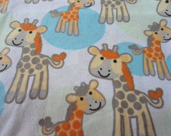 "37"" x 41' Receiving Blanket with large giraffes on white back ground"