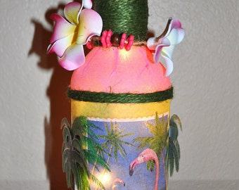 3D Flamingo lighted bottle you have to see this one, it's beautiful!  3D palm trees, flamingo, lei - and it's a nightlight!