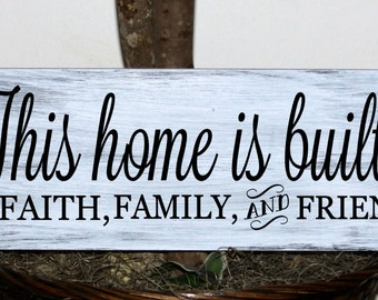 This home is built on faith family and friends wood sign