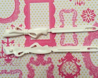 White bow vintage barrettes