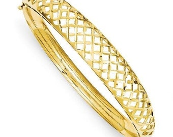 14k gold Diamond Cut Bangle.