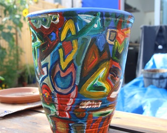 Example of large sized terracotta pot, vividly painted with acrylics.