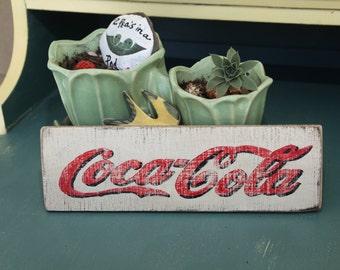 Coca Cola logo sign