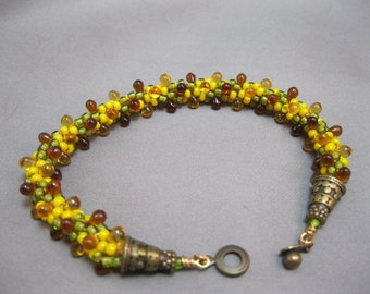 Yellow, gold, brown hand woven beaded bracelet