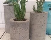 "Concrete Succulent Planters. Urba Planters. (set of 3) Natural gray.  Enter Promo code ""LOVE1"" to recieve 10% off entire order."
