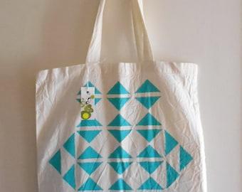 Bag Tote Bag geometric with cyan blue triangle.